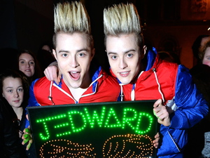 Jedward outside the stage door of the Olympia Theatre before their panto 'Jedward & the Magic Lamp' when fan, Sherry Leung, made them an illuminated sign.
