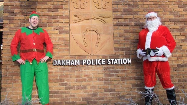 Leicestershire Pc Joe Lloyd and police community support officer Jay Cooper dress up as Santa and an Elf