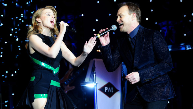 Kylie Minogue and Jason Donovan perform during the Hit Factory Live Christmas Cracker concert, at the O2 arena in London.