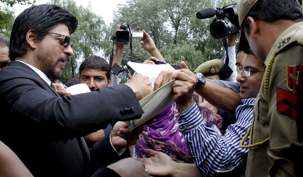 Shah Rukh Khan signs autographs for fans after a press conference in Srinagar, India, Thursday, Sept. 6, 2012. Khan is in the Indian part of Kashmir, where his mother was from, to shoot his latest film.