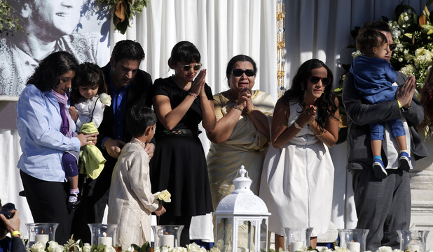 Sukanya Rajan, third from right, is joined by daughter Anoushka Shankar, second from right, stepdaughter Nora Jones, center, and other family members during a memorial service for Ravi Shankar