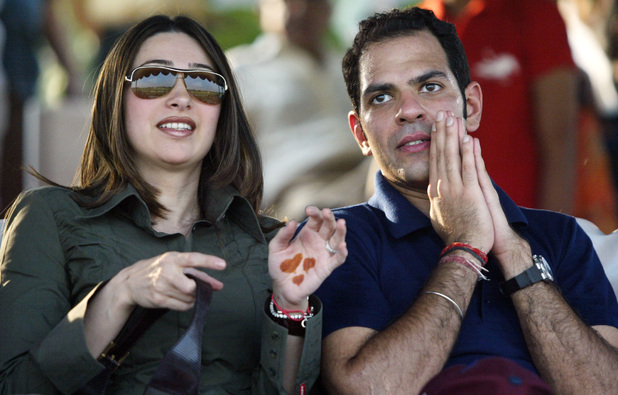 Bollywood actress Karisma Kapoor, left, and her husband Sunjay Kapur look on during a polo match in New Delhi, India, Sunday, Oct. 23, 2005. Kapoor and Kapur have patched up their problems, and have moved back to Sunjay Kapurs home in New Delhi.
