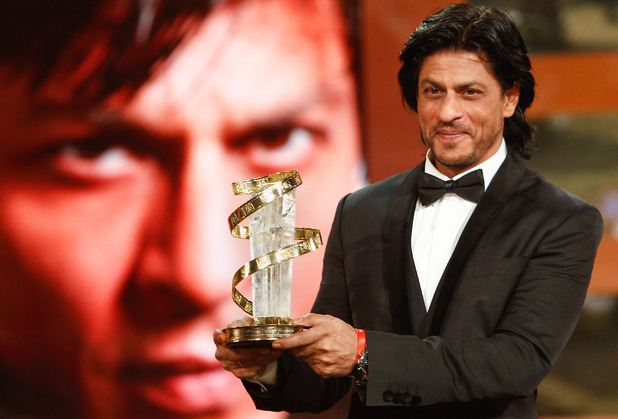 Shah Rukh Khan poses with his trophy after receiving award for his lifetime career during the 11th Marrakech International Film Festival in Marrakech, Morocco, Friday, Dec. 2, 2011. The Festival runs through Dec. 2-10
