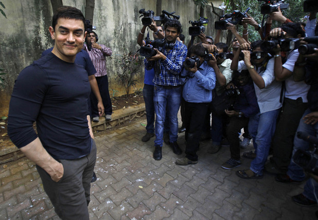 "Aamir Khan poses for photographers after a press conference to promote his new film ""Talaash,"" or Search, at his residence in Mumbai, India, Tuesday, Dec. 4, 2012."