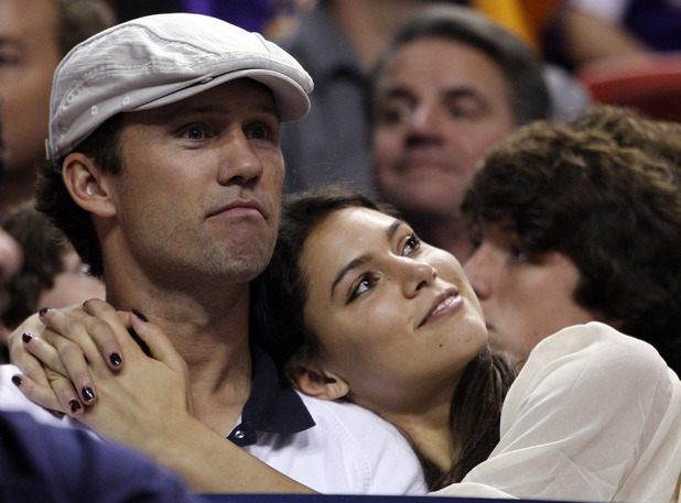 Jeffrey Donovan and Michelle Woods watch the Miami Heat and Los Angeles Lakers NBA basketball game in Miami