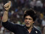 Kolkata Knight Riders' co owner and Bollywood star Shah Rukh Khan, center celebrates after his team won their Indian Premier League (IPL) cricket playoff match against Delhi Daredevils in Pune, India, Tuesday, May 22, 2012.