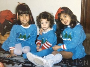 Kardashian sisters in matching Christmas jumpers, Christmas 1985