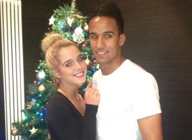 Helen Flanagan and Scott Sinclair pose next to the tree on Christmas Day 2012