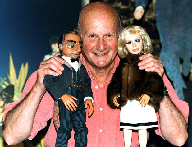 The Creator of the TV show &#39;Thunderbirds&#39; Gerry Anderson says farewell to two of his most famous puppets, Lady Penelope and Parker at Planet Hollywood in London (2001)