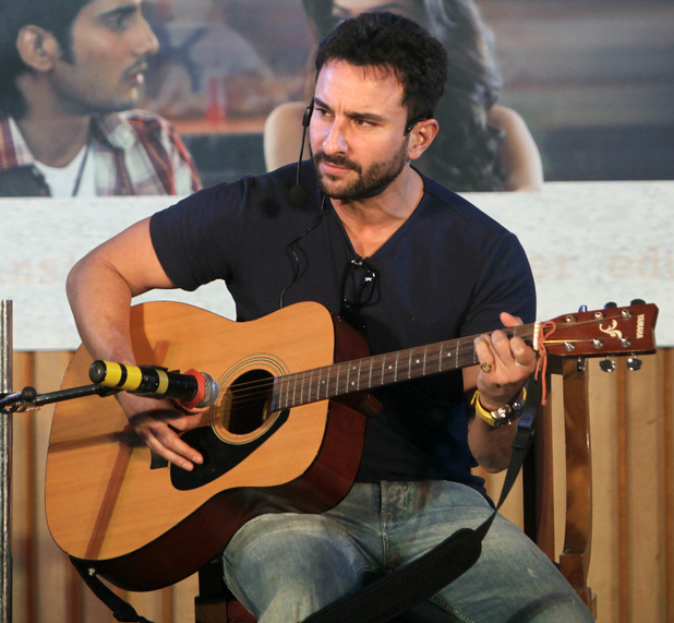 "Bollywood actor Saif Ali Khan plays guitar during a promotion of his film ""Aarakshan"" in Mumbai, India, Tuesday, Aug. 2, 2011."