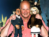 The Creator of the TV show 'Thunderbirds' Gerry Anderson says farewell to two of his most famous puppets, Lady Penelope and Parker at Planet Hollywood in London (2001)
