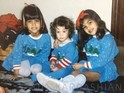 Kim Kardashian shares a Christmas photo of her and sisters from their childhood.