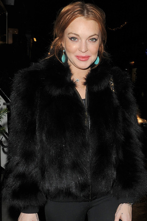 Lindsay Lohan arrives at Nozomi restaurant with her minder and some friends. The group stayed for around two hours. London, England - 02.01.13 Featuring: Lindsay Lohan Where: London, United Kingdom When: 02 Jan 2013