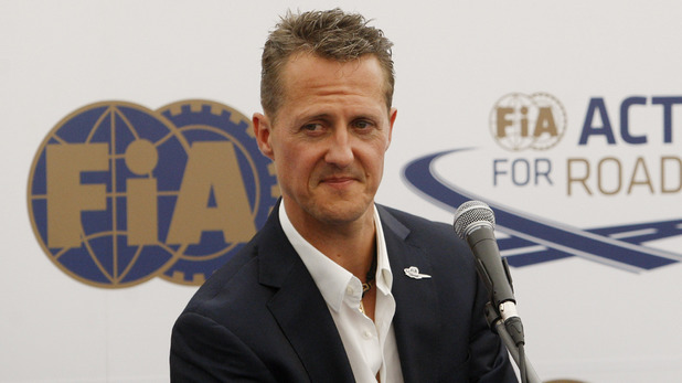 Michael Schumacher (left) speaks at an FIA road safety event in Prague, July 2012 (FIA president Jean Todt appears to the right of the photo)