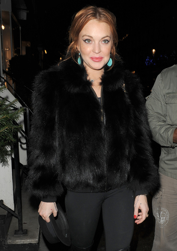 Lindsay Lohan arrives at Nozomi restaurant with her minder and some friends. The group stayed for around two hours. London, England - 02.01.13 Featuring: Lindsay Lohan Where: London, United Kingdom When: 02 Jan 2013 Credit: Will Alexander/WENN.com