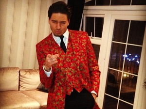 Mario Falcone poses in custom holly suit at Christmas