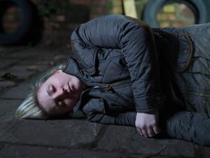 Esther lays unconscious.
