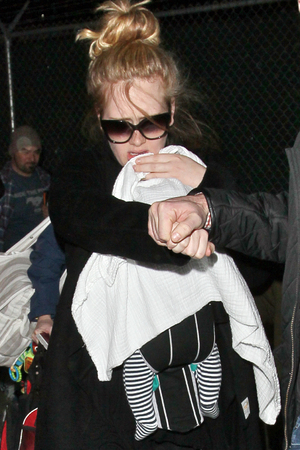 Adele arrives into Los Angeles International Airport (LAX) amid tight security. Her baby son is hidden from view under a blanket.Featuring: Adele, Adele Atkins