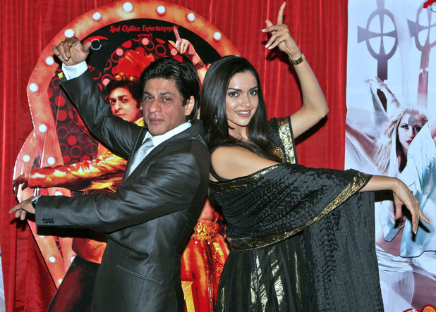 Deepika Padukone, right, and Shah Rukh Khan, left, pose for photographers at a photo call for 'Om Shanti Om' at the Empire Leicester Square, London.Thursday Nov. 8, 2007.