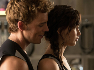 &#39;The Hunger Games: Catching Fire&#39; still: Sam Claflin and Jennifer Lawrence