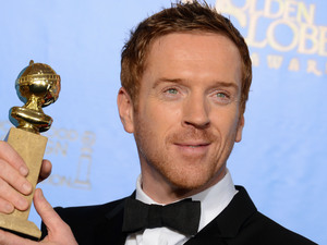 "Damian Lewis poses with the award for best performance by an actor in a television series – drama for ""Homeland"" backstage at the 70th Annual Golden Globe Awards"