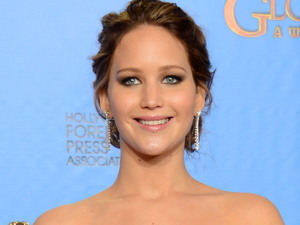 Jennifer Lawrence poses with the award for best performance by an actress in a motion picture comedy or musical for Silver Linings Playbook in the press room at the 70th Annual Golden Globe Awards 