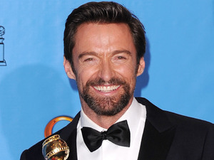 "Hugh Jackman poses with the award for for actor (musical or comedy) for ""Les Misérables"" backstage at the 70th Annual Golden Globe Awards"