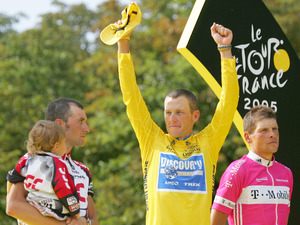 Lance Armstrong (pictured with Ivan Basso and child, plus Jan Ulrich) - seventh straight Tour de France win in 2005
