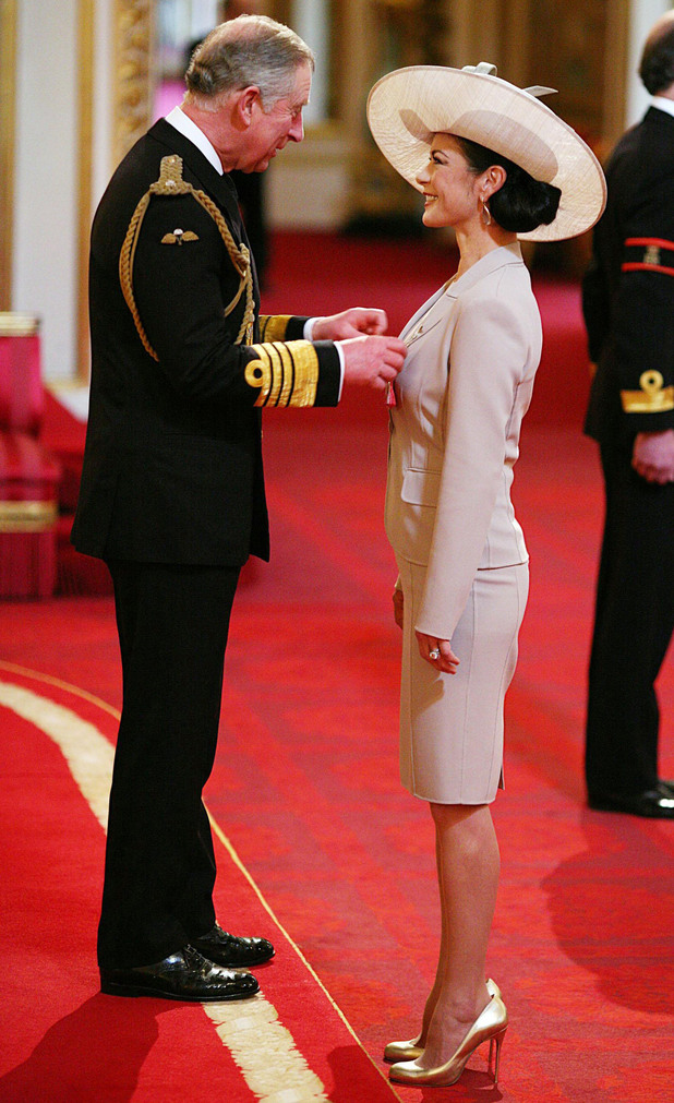 Hollywood actress Catherine Zeta Jones is made a Commander of the British Empire (CBE) by the Prince of Wales at Buckingham Palace in London.
