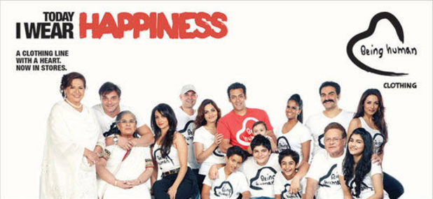 "Salman Khan and his family in a Being Human poster featuring the tag line ""Today I wear happiness"""