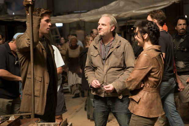 Francis Lawrence on set with Liam Hemsworth and Jennifer Lawrence