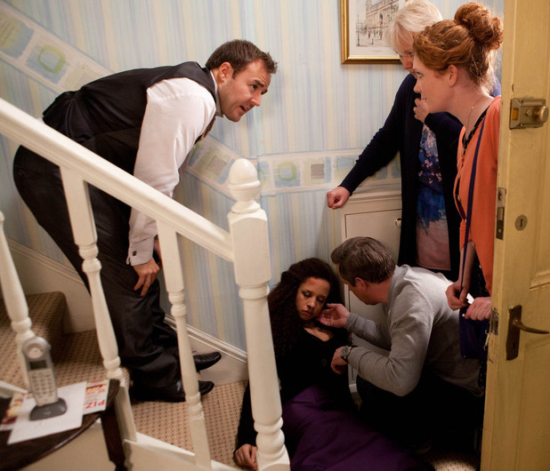 8045: Kirsty is injured at the bottom of the stairs after falling during an argument with Tyrone