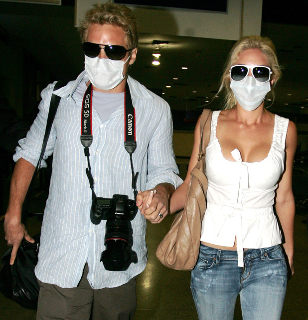 Heidi Montag and Spencer Pratt arrive at LAX after returning from their Cancun, Mexico honeymoon. The newlyweds are wearing facemasks to protect themselves from the Swine Flu epidemic