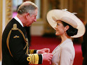 Catherine Zeta Jones says Charles was interested in her breast at CBE ceremony.