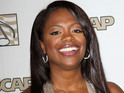 Kandi Burruss is engaged to producer she met on Real Housewives.