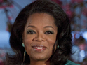 Oprah Winfrey injures her back while picking up a gift from Tyler Perry.