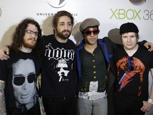 Members of American rock band Fall Out Boy from right to left, Patrick Stump, Pete Wentz, Joe Trohman and Andy Hurley arrive for a performance onboard the Australian Warship HMAS Tobruk in Sydney, Australia,