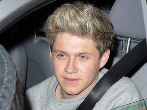 &#39;One Direction&#39; arriving at Heathrow Airport
