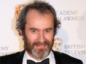 Stephen Dillane with the Best Actor Award received for The Shooting of Thomas Hurndall, stands with presenter Lindsay Duncan at the British Academy Television Awards at the Royal Festival Hall in central London.