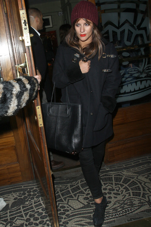 Caroline Flack leaving the Groucho after having drinks with James Arthur who left out by the back door