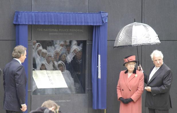 Michael Winner alongside Queen Elizabeth II