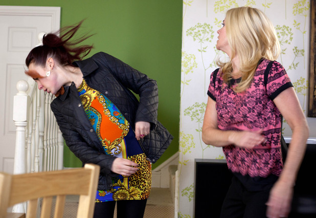 Diane throws Sinead's laptop across the room and slaps her