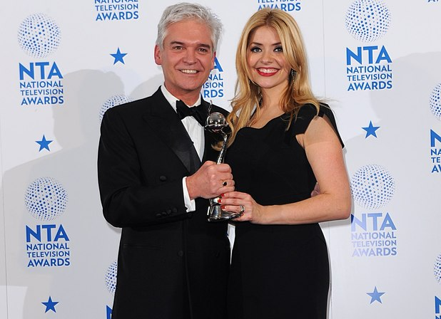 Philip Schofield and Holly Willoughby with the award for Best Factual Programme for 'This Morning', in the press room at the 2013 National Television Awards at the O2 Arena, London.