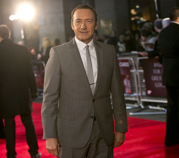 Actor Kevin Spacey arrives on the red carpet for the UK Premiere of 'House of Cards' at a Leicester Square cinema in London, Thursday, Jan. 17, 2013.