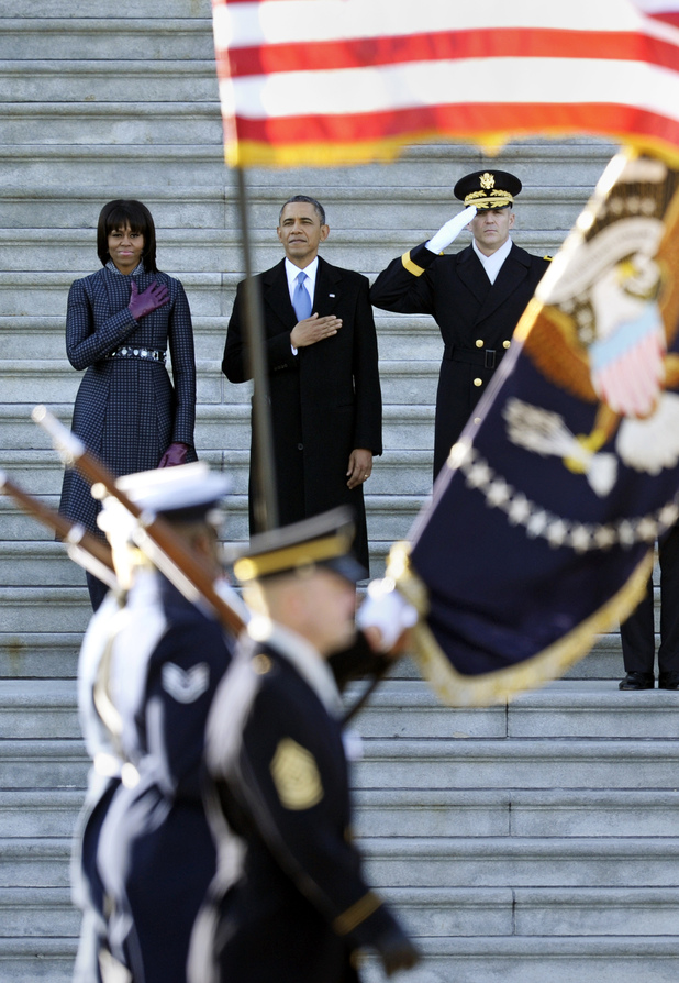 Barack Obama, Michelle Obama, salute a military honour guard, sident reviews the troops on Capitol Hill in Washington