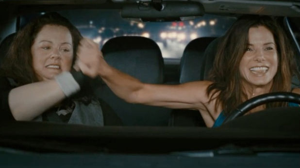 Sandra Bullock and 'Bridesmaids' star Melissa McCarthy bring 'The Heat' in Digital Spy's exclusive red band trailer.