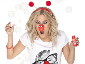 Comic Relief: Caroline Flack wearing a Red Nose Day T-shirt