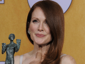 Julianne Moore poses backstage with the award for best female actor in a TV movie or miniseries in the press room at the 19th Annual Screen Actors Guild (SAG) Awards