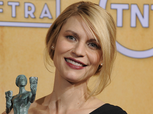 Claire Danes poses backstage with the award for best female actor in a drama series in the press room at the 19th Annual Screen Actors Guild (SAG) Awards
