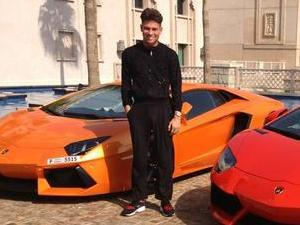 TOWIE's Joey Essex posing by some cars in Dubai